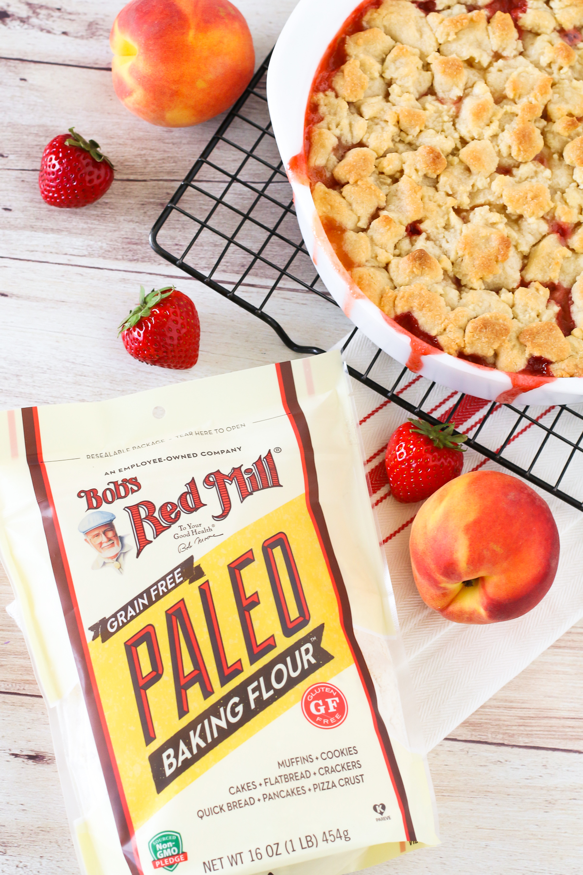 Grain Free Vegan Strawberry Peach Crisp. Golden grain free crisp topping, made with Bob's Red Mill Paleo Baking Flour. The combo of sweet, juicy strawberries and peaches makes this a summertime must!