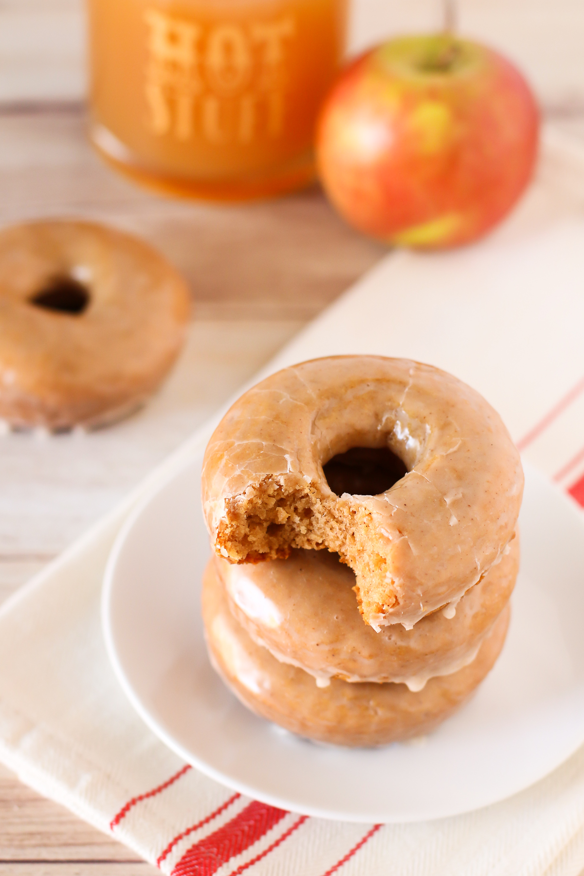 Gluten Free Vegan Baked Apple Cider Donuts. Cake-like, baked apple cider donuts with a simple cinnamon glaze. This recipe is fall-tastic!