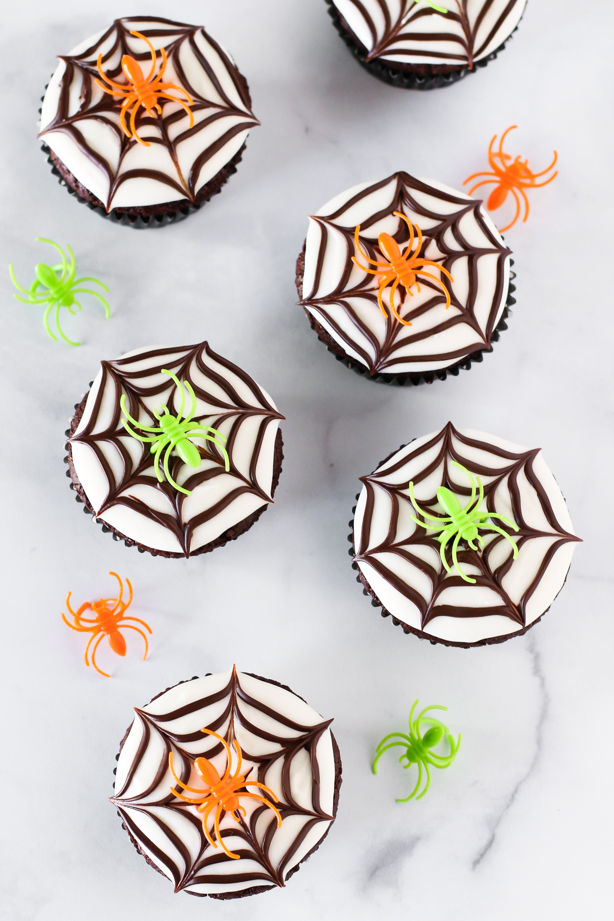 Gluten Free Vegan Chocolate Spiderweb Cookies. These easy-peasy, creepy spiderweb cupcakes are sure to be a hit at your Halloween party this year!