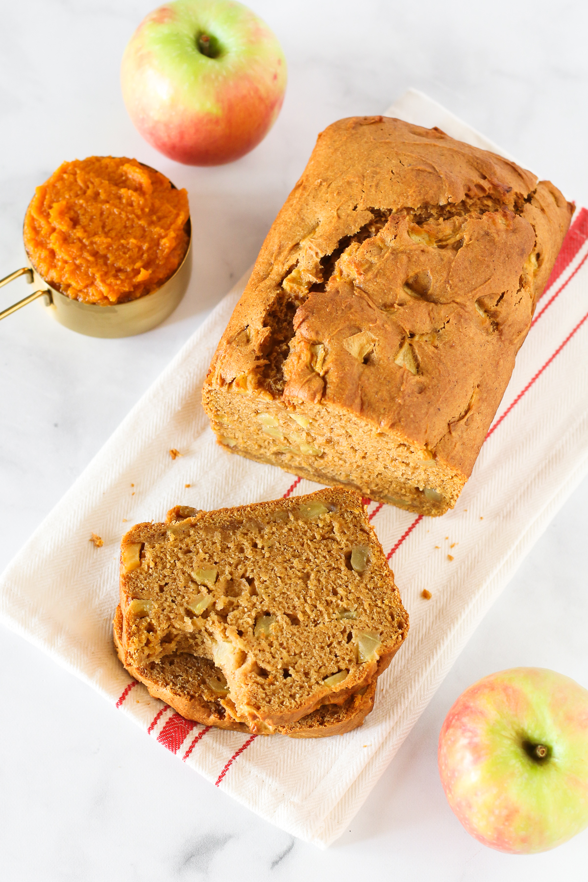 Gluten Free Vegan Pumpkin Apple Bread. Moist pumpkin bread, perfectly spiced and loaded with fresh apples.