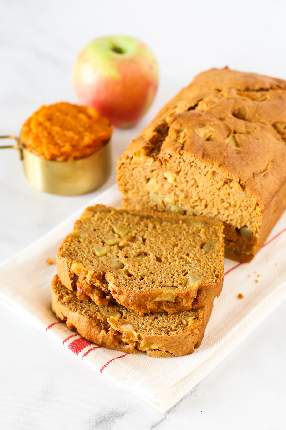 Gluten Free Vegan Pumpkin Apple Bread. Thick slices of pumpkin bread, loaded with fresh apples. A lovely fall treat.