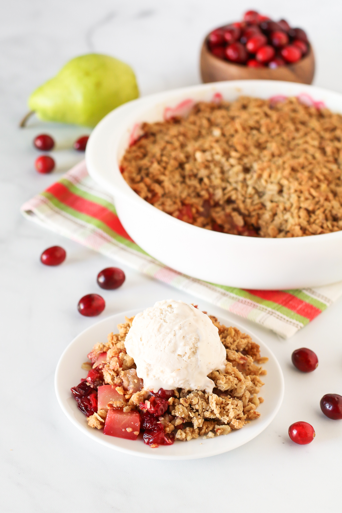 Gluten Free Vegan Cranberry Pear Crisp. Tender pears, tart cranberries and a golden oat-pecan crumb topping. A scrumptious holiday dessert!