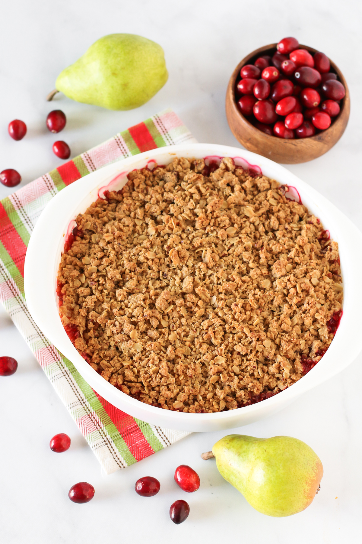 Gluten Free Vegan Cranberry Pear Crisp. Tender pears, tart cranberries and a golden oat-pecan crumb topping. A rustic, easy holiday dessert!