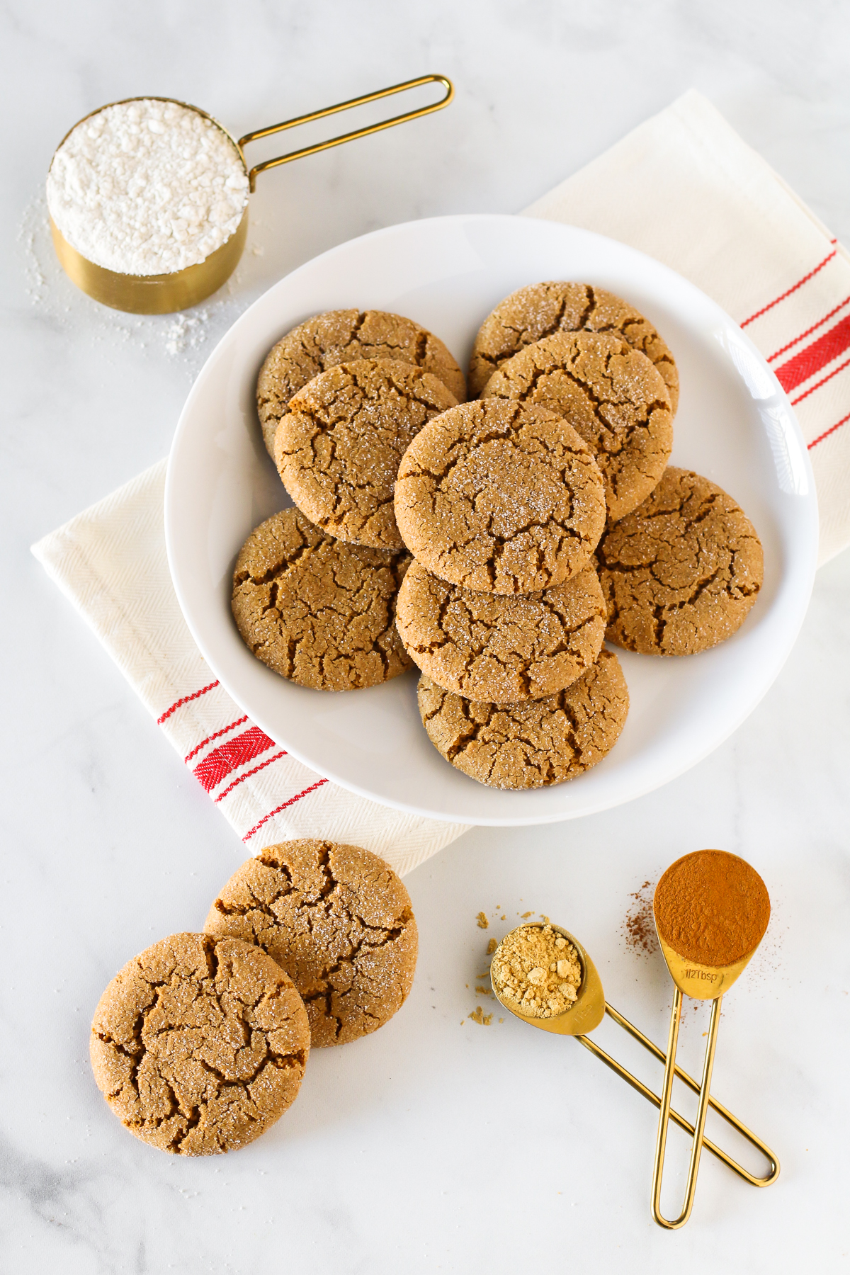 Gluten Free Vegan Molasses Cookies. Soft, chewy and perfectly spiced. A plate of these cookies is sure to be a hit at any holiday party!