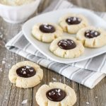 Gluten Free Vegan Salted Chocolate Almond Thumbprint Cookies. Soft almond thumbprint cookies, filled with a decadent chocolate ganache and topped with beautiful sea salt flakes.
