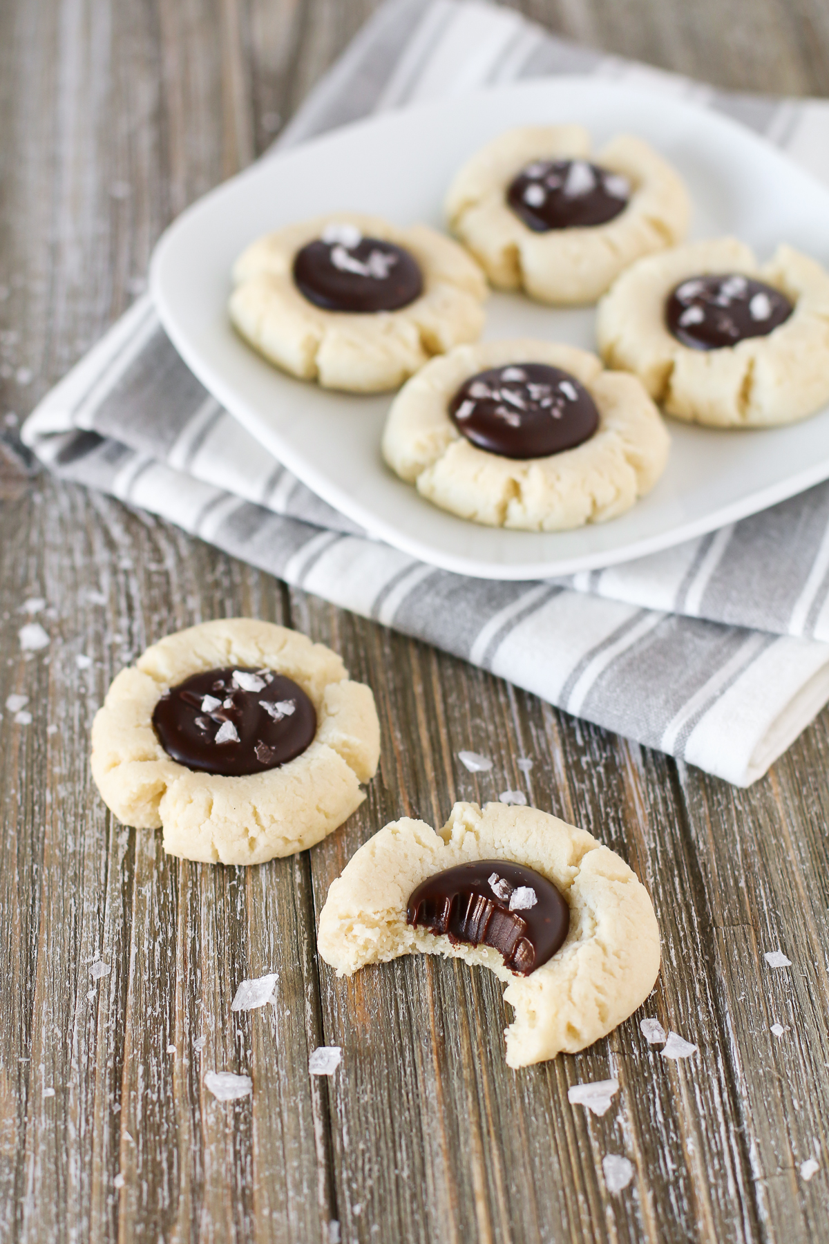 s. Soft almond thumbprint cookies, filled with a decadent chocolate ganache and topped with sea salt flakes.