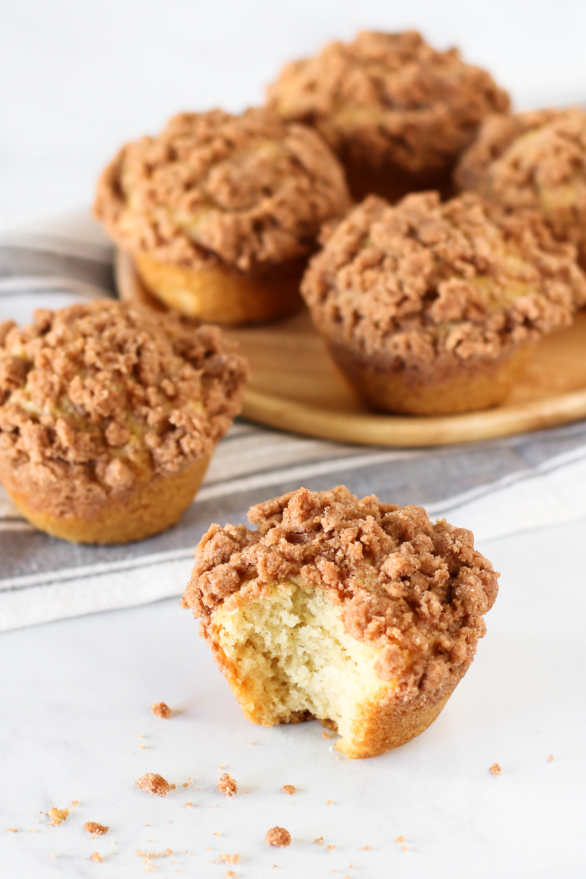 Gluten Free Vegan Coffee Cake Muffins. Fluffy vanilla muffins with a cinnamon crumb topping. Perfectly paired with a cup of coffee or tea!