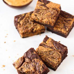 Gluten Free Vegan Peanut Butter Swirl Brownies. Fudgy brownies, swirled with creamy peanut butter. Can't go wrong with that combo!