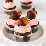 Gluten Free Vegan Chocolate Covered Strawberry Cupcakes. Chocolate cupcakes with a fluffy strawberry buttercream, topped with a beautiful chocolate covered strawberry.