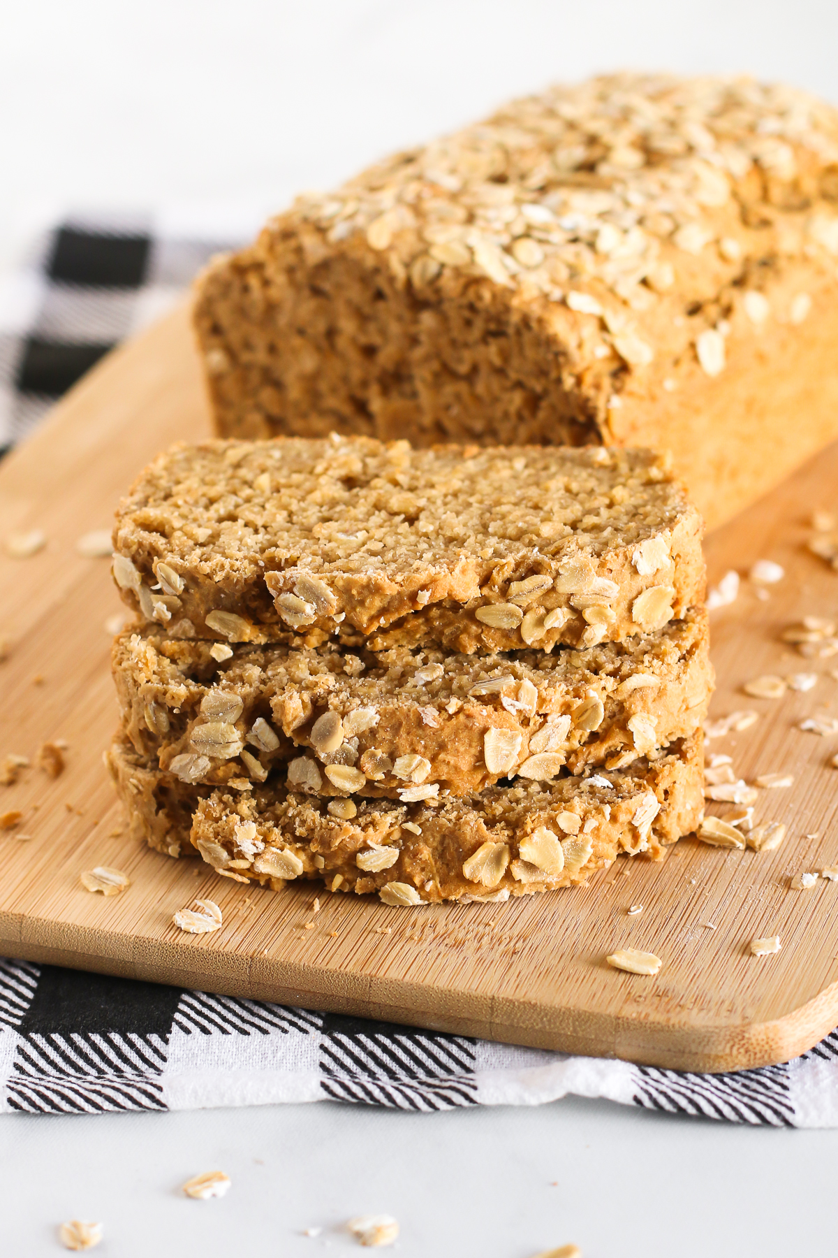 Gluten Free Vegan Oatmeal Quick Bread. Slices of soft oat bread, ready for your favorite jam or nut butter!