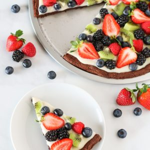 Gluten Free Vegan Brownie Fruit Pizza. Chocolate brownie crust with a cream cheese frosting, loaded with fresh fruit. A beautiful dessert pizza!