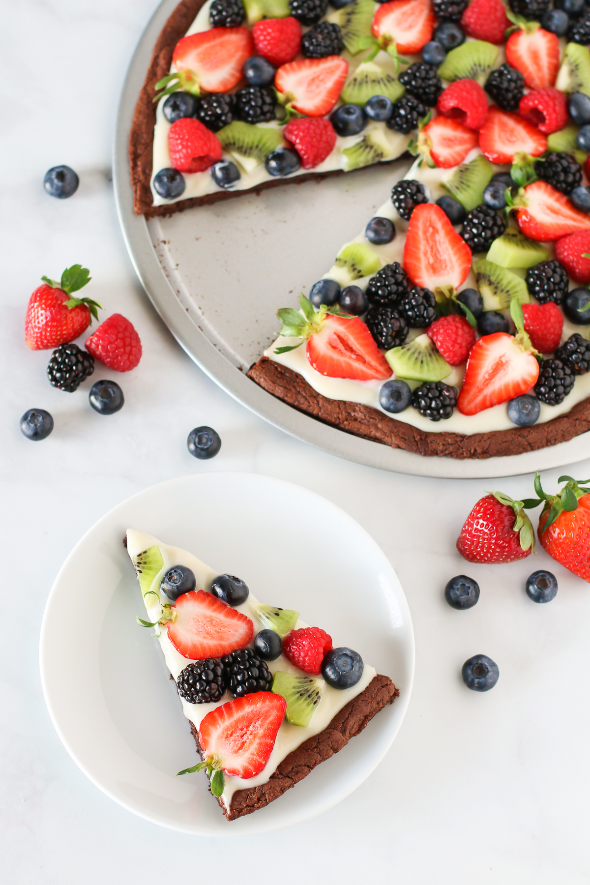 Gluten Free Vegan Brownie Fruit Pizza. Chewy brownie crust with a cream cheese frosting, loaded with fresh fruit. A beautiful dessert pizza!