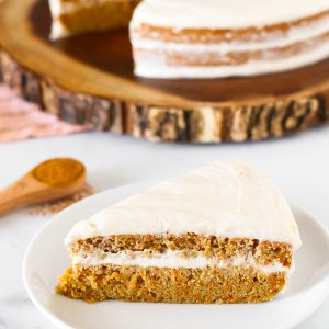 Gluten Free Vegan Carrot Cake. Layers of moist, spiced carrot cake and decadent cream cheese frosting. The classic cake made allergen free!