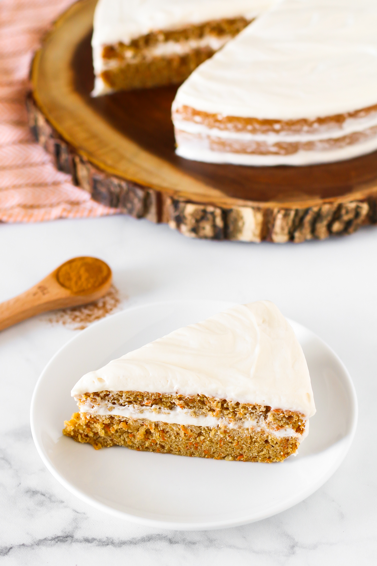 Gluten Free Vegan Carrot Cake. Layers of moist, spiced carrot cake and decadent cream cheese frosting.