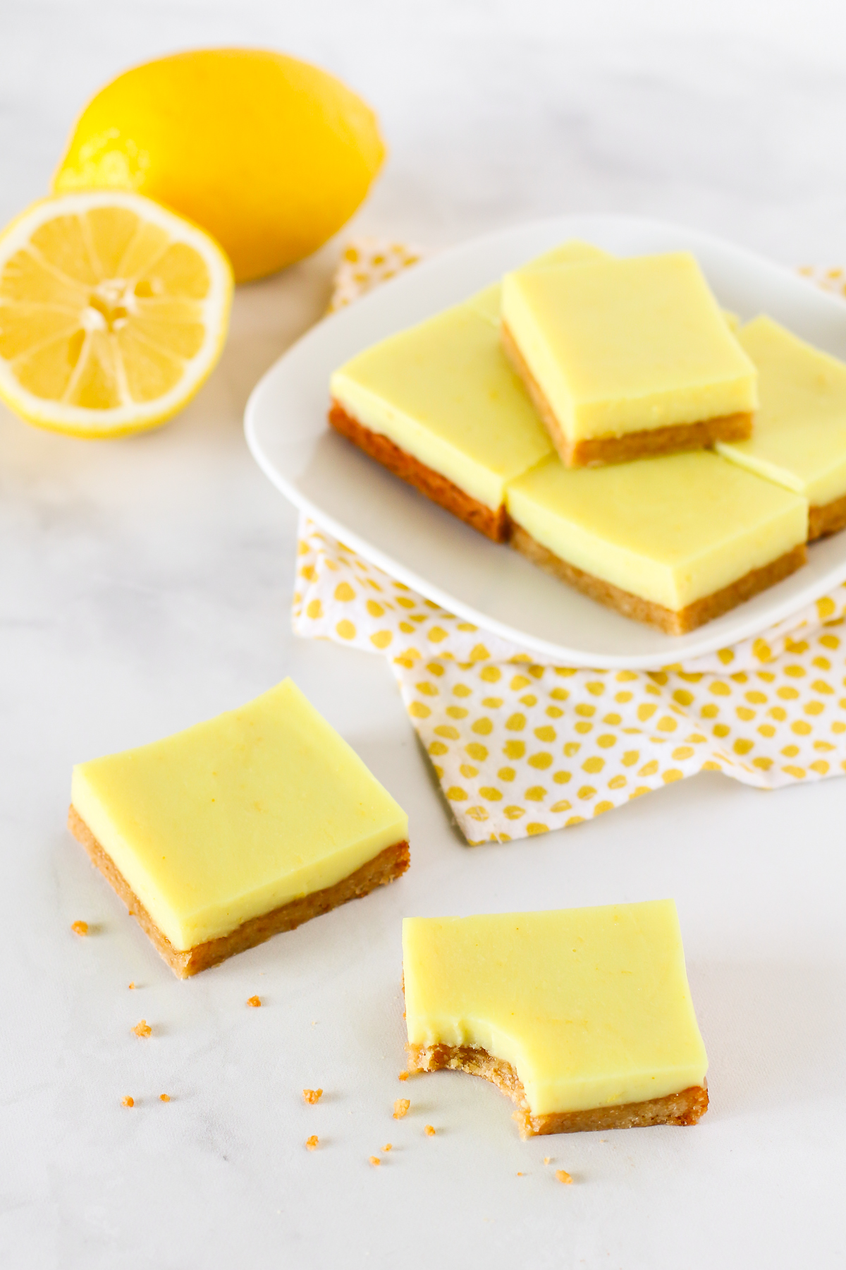 Gluten Free Vegan Lemon Bars. Chewy almond crust with a layer of creamy lemon deliciousness make these lemon bars simply irresistible!