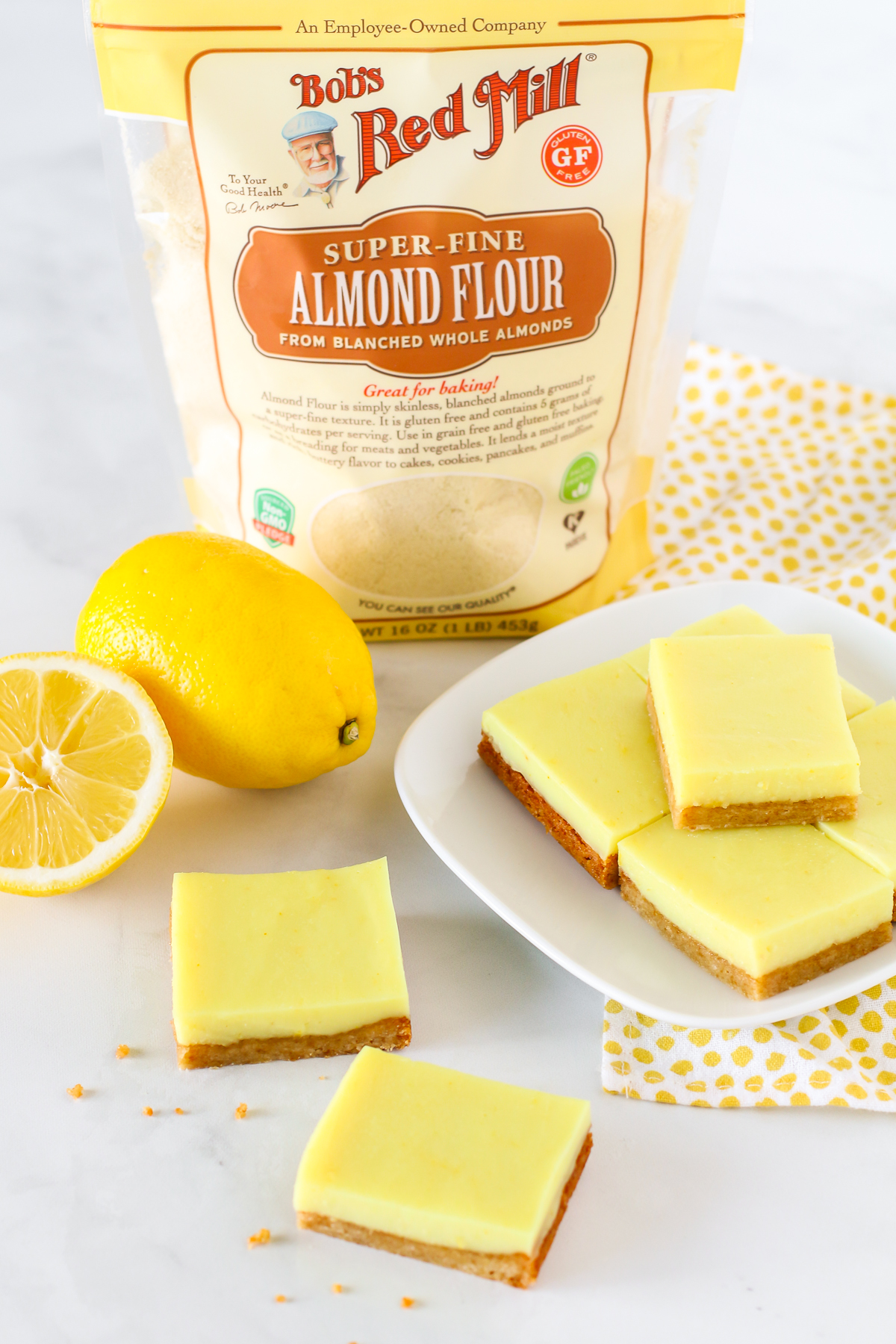 Gluten Free Vegan Lemon Bars. Chewy crust made with Bob's Red Mill almond flour, topped with a creamy layer of lemon deliciousness.