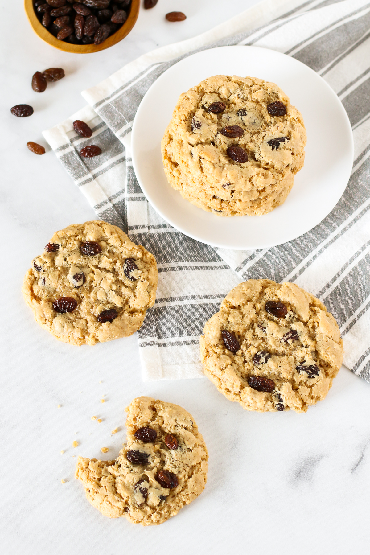 Gluten Free Vegan Oatmeal Raisin Cookies. Chewy oatmeal cookies, with a touch of cinnamon and the perfect amount of sweet raisins.