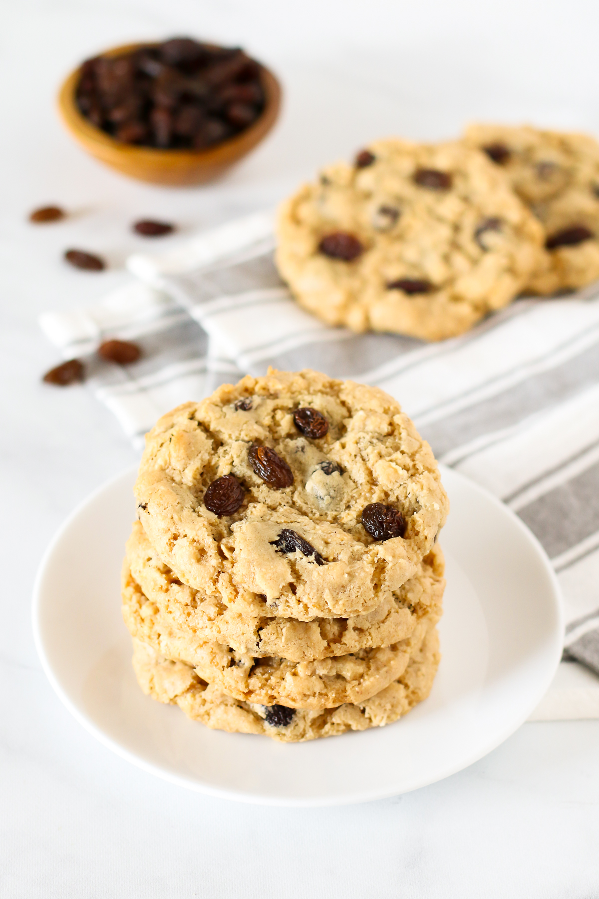 Gluten Free Vegan Oatmeal Raisin Cookies. Chewy oatmeal cookies, loaded with sweet raisins. Can't go wrong with this classic cookie!