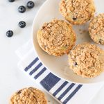 Gluten Free Vegan Blueberry Crumb Muffins. Tender muffins with sweet blueberries, with a beautiful cinnamon crumb topping.