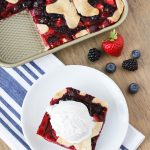 Gluten Free Vegan Triple Berry Slab Pie. Flaky pie crust, filled with fresh strawberries, blueberries and blackberries. Baked in a sheet pan until bubbly and golden brown!