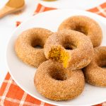 Gluten Free Vegan Cinnamon Sugar Pumpkin Donuts. Fluffy baked pumpkin donuts, dipped in cinnamon sugar. These are what donut dreams are made of!