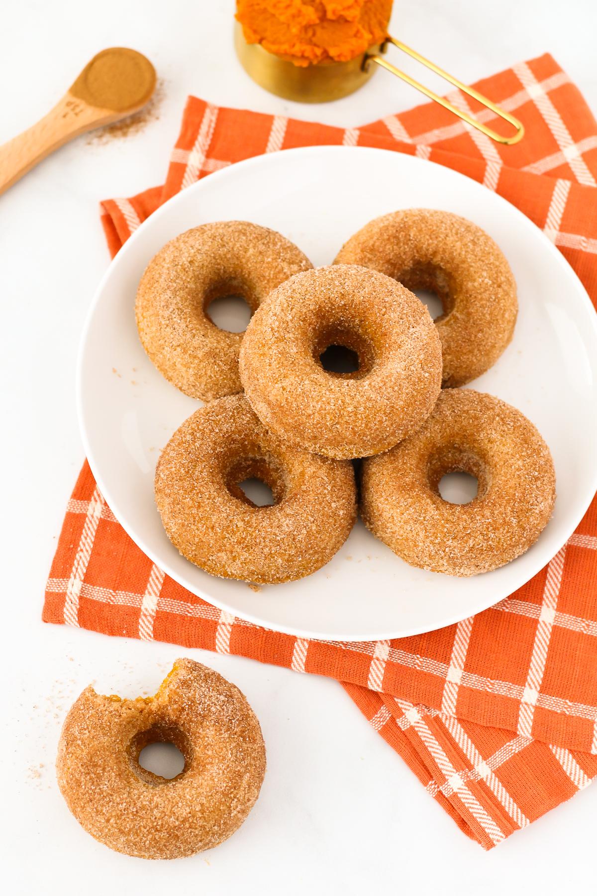 Gluten Free Vegan Cinnamon Sugar Pumpkin Donuts. Fluffy baked pumpkin donuts, coat in cinnamon sugar. The most perfect fall breakfast treat!