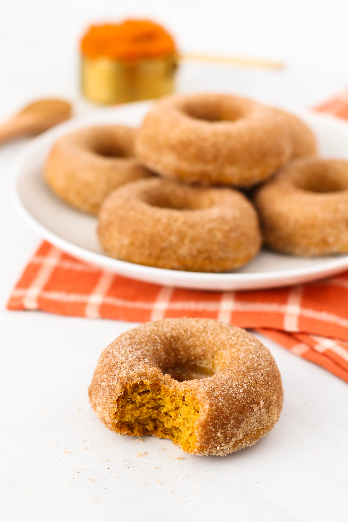 Gluten Free Vegan Cinnamon Sugar Pumpkin Donuts. Fluffy baked pumpkin donuts, coated in cinnamon sugar. These are what donut dreams are made of!