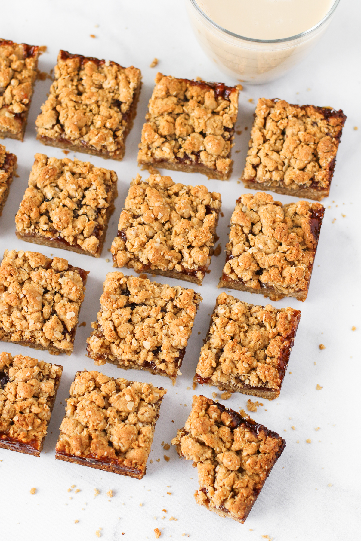Gluten Free Vegan Peanut Butter and Jelly Oat Bars. The classic combination of creamy peanut butter and strawberry jelly in a oat crumb bar. What's not to love?