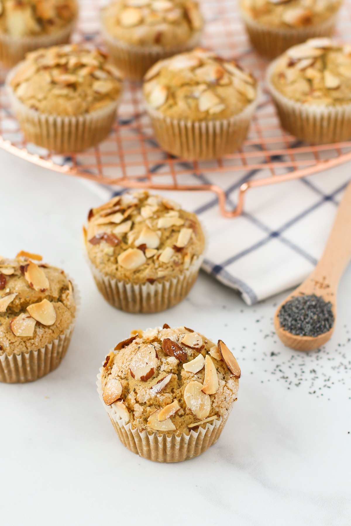 Gluten Free Vegan Almond Poppyseed Muffins. Tender poppyseed muffins, with the crunch of toasted almonds. Such a lovely morning treat!