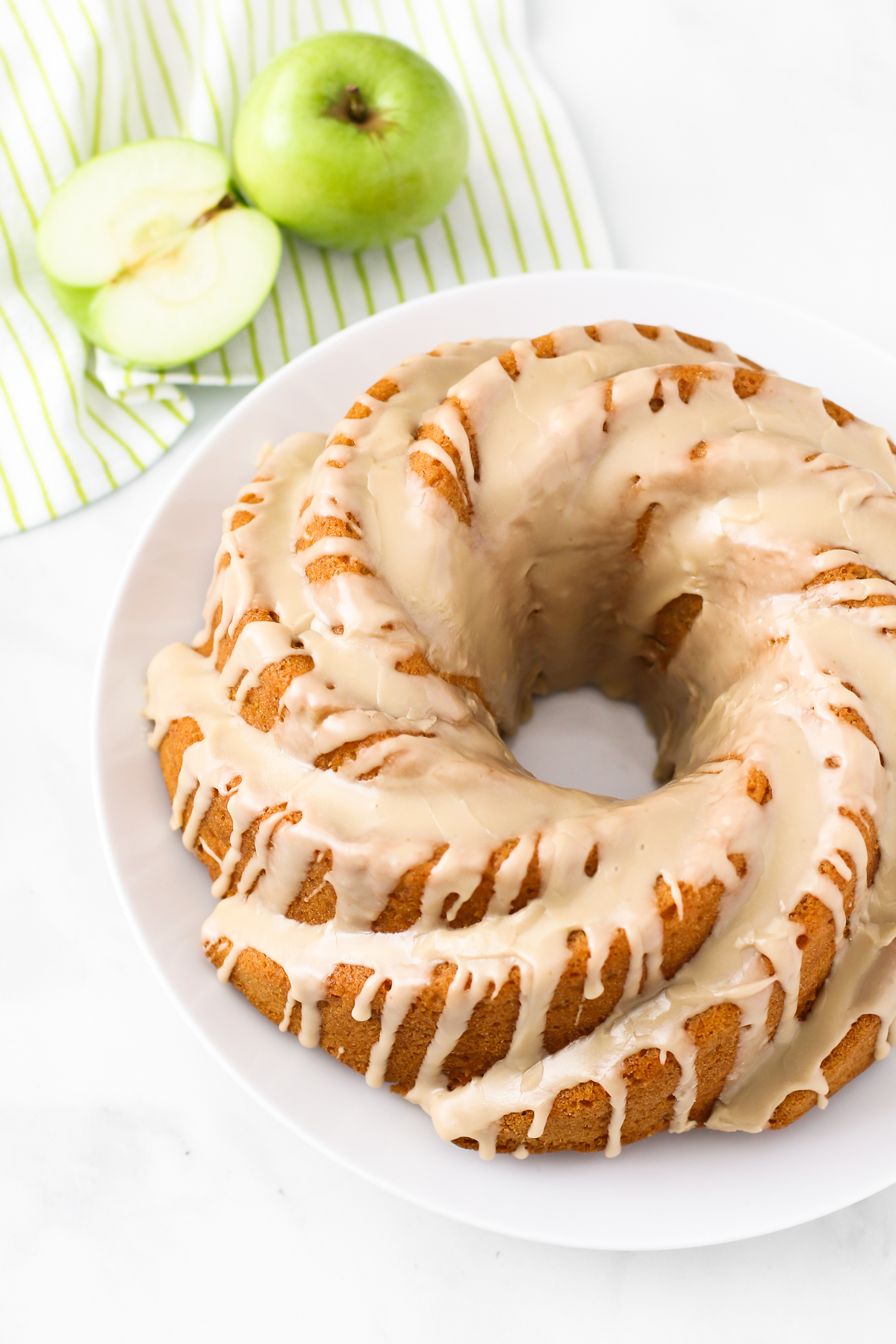 Gluten Free Vegan Caramel Apple Bundt Cake. As the decadent caramel glaze is dripping down the sides of this gluten free vegan caramel apple bundt cake, you can't help but want a slice.