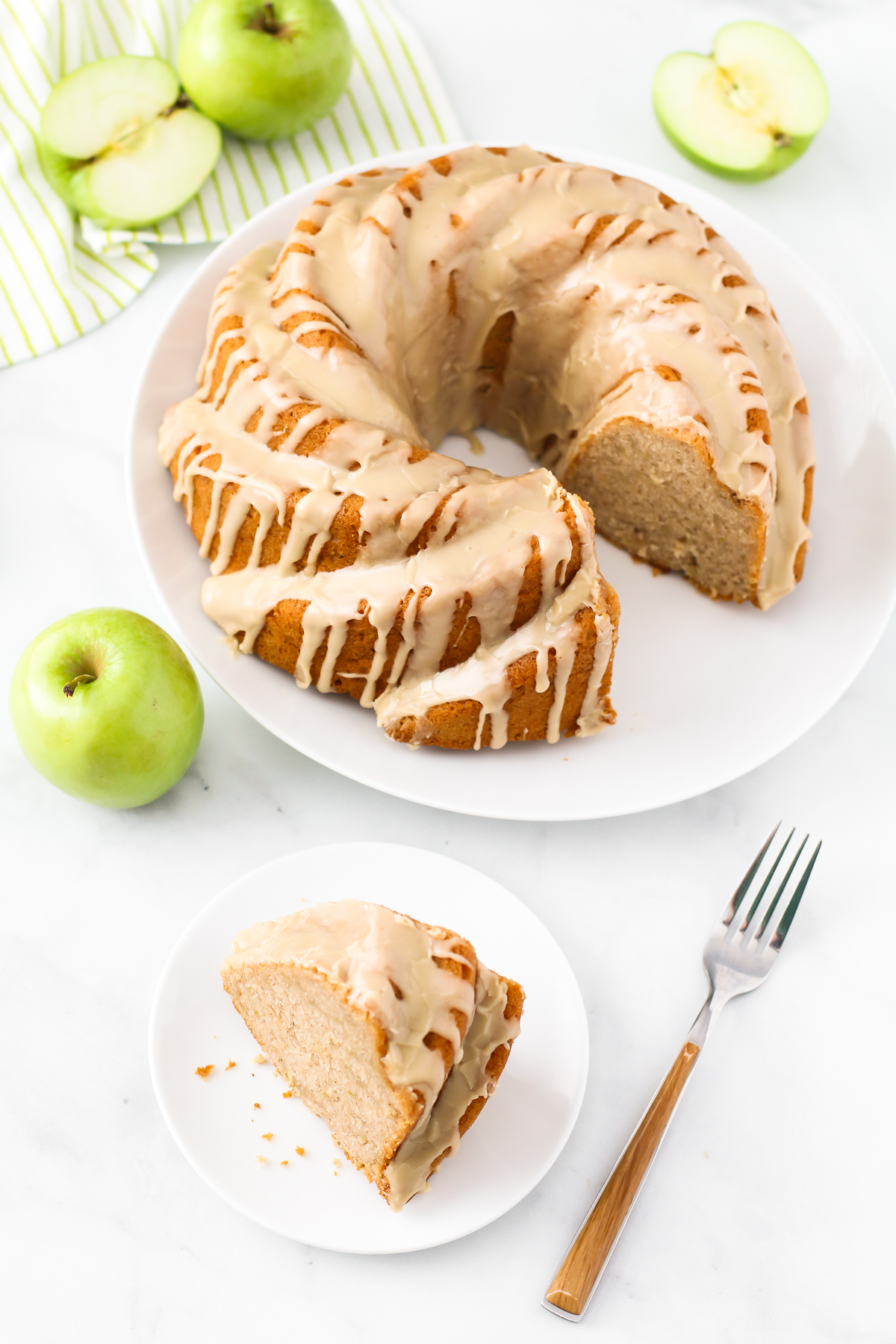 Gluten Free Vegan Caramel Apple Bundt Cake. This tender apple bundt cake, covered in a caramel glaze, makes for one stunning fall dessert!