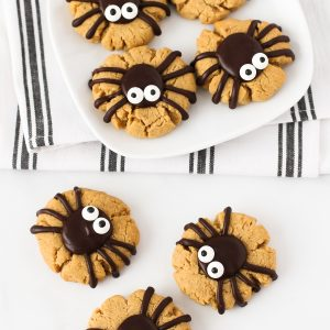 Gluten Free Vegan Peanut Butter Spider Cookies. How cute are these peanut butter thumbprint cookies, topped with a delicious chocolate spider?