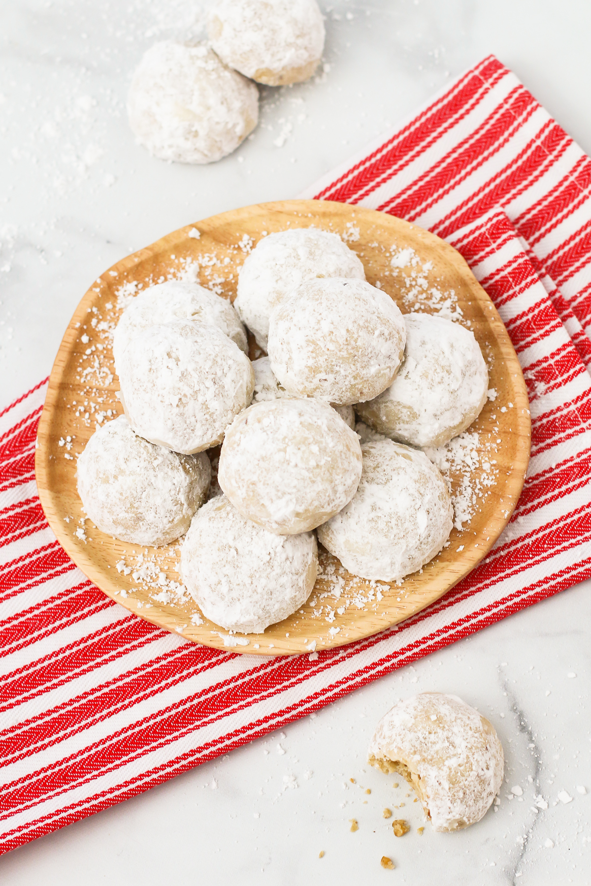 Gluten Free Vegan Snowball Cookies. Also known as Russian tea cakes, these powdered sugar coated cookies are made with flavorful toasted walnuts. A buttery, simple holiday cookie!
