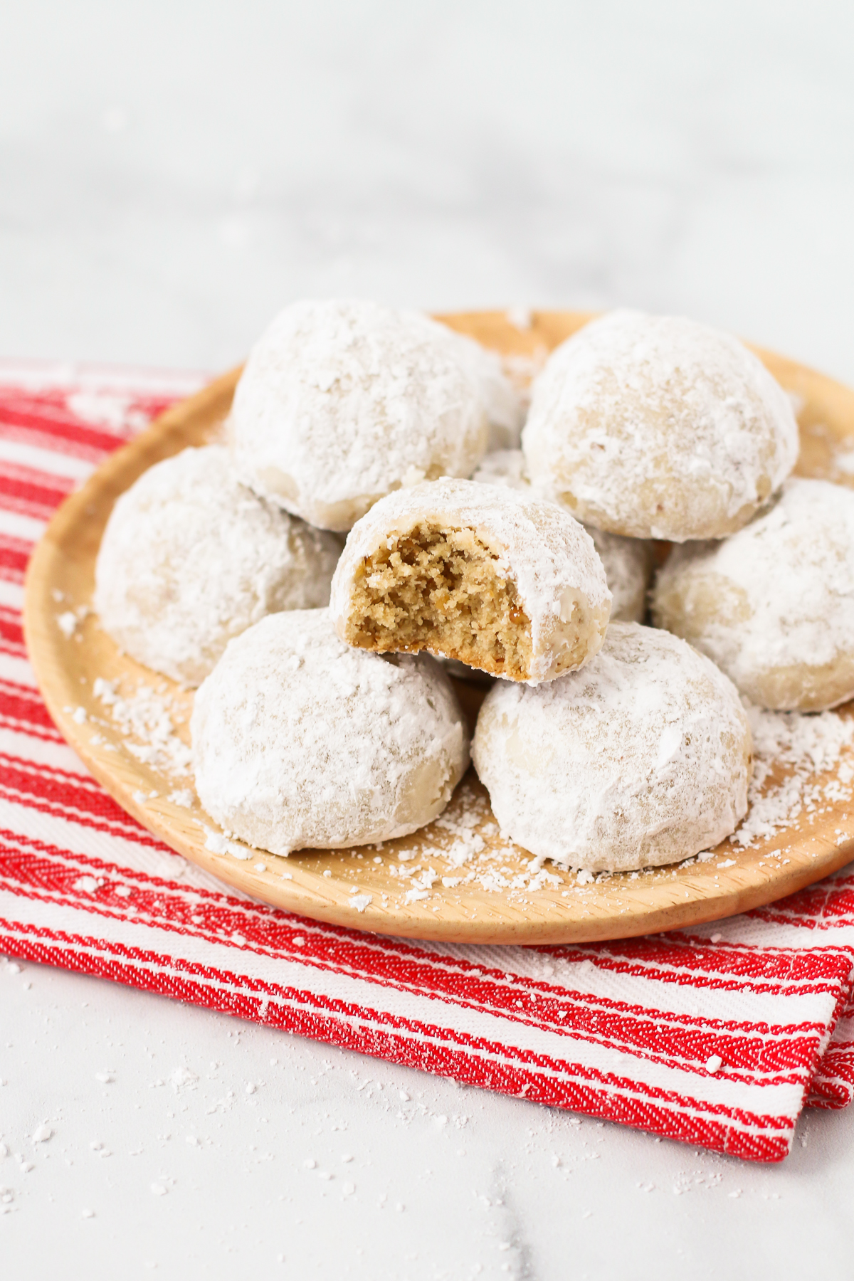 A simple holiday cookie that's made with toasted walnuts and rolled in powdered sugar. What's not to love about these gluten free vegan snowball cookies?