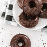 Who wouldn't go for one of these gluten free vegan baked chocolate donuts? Extra chocolatey cake donuts, dipped in a decadent chocolate glaze. Can't forget the chocolate sprinkles!