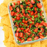 Vegan 7 Layer Bean Dip. Layers of beans, guacamole, creamy taco sauce, salsa and all of the vibrant Mexican flavors. No one will even miss the dairy!