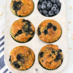 Gluten Free Vegan Blueberry Oatmeal Muffins. Hearty oatmeal muffins, bursting with sweet blueberries. Quite the morning treat!