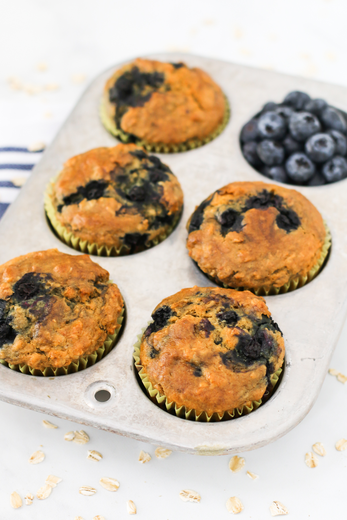 Gluten Free Vegan Blueberry Oatmeal Muffins. Hearty oatmeal muffins, bursting with sweet blueberries.