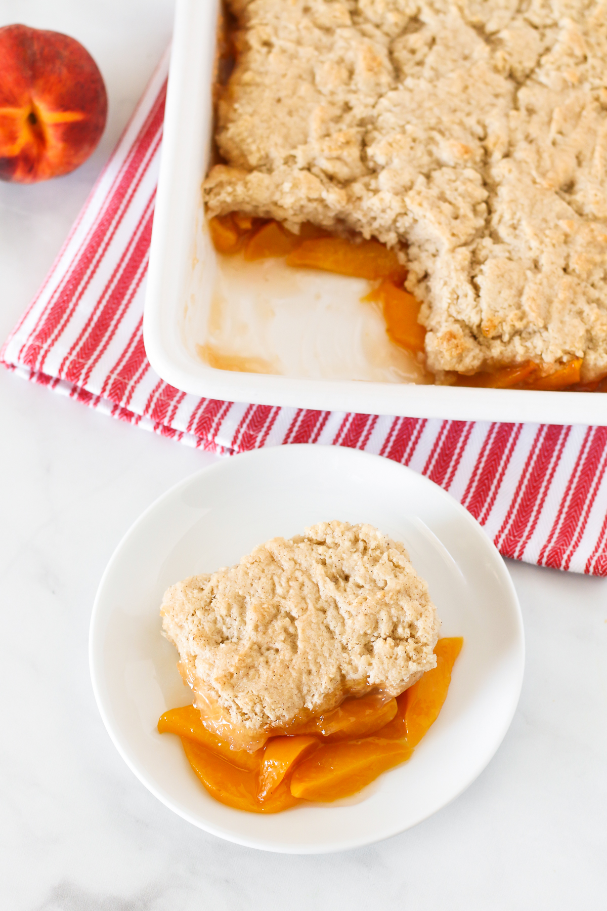 Gluten Free Vegan Peach Cobbler. Perfectly golden biscuit-like topping over sweet, juicy fresh peaches. A summertime must!