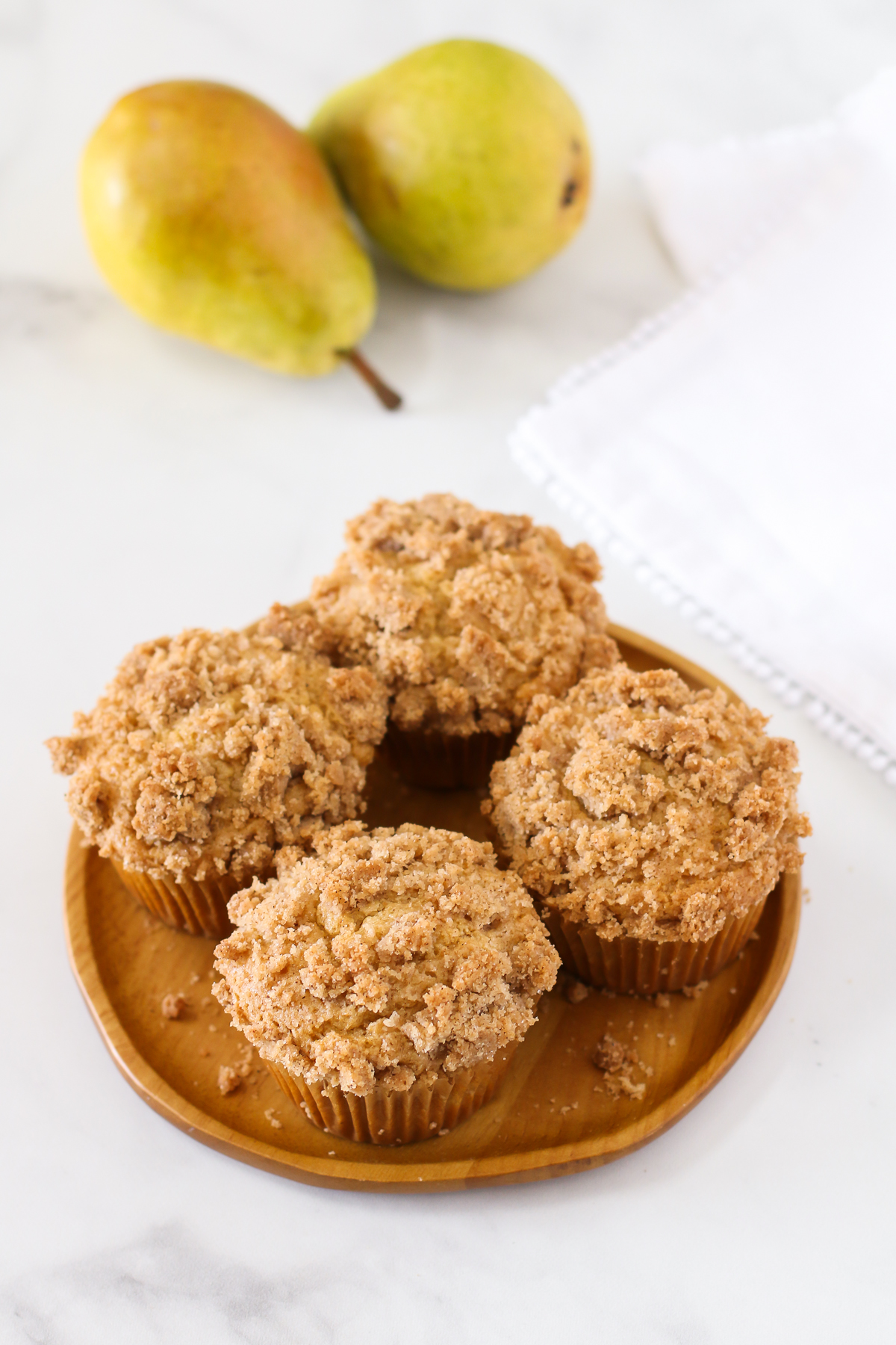 Gluten Free Vegan Pear Crumb Muffins. Tender, spiced muffins with diced fresh pears. A lovely fall breakfast treat!