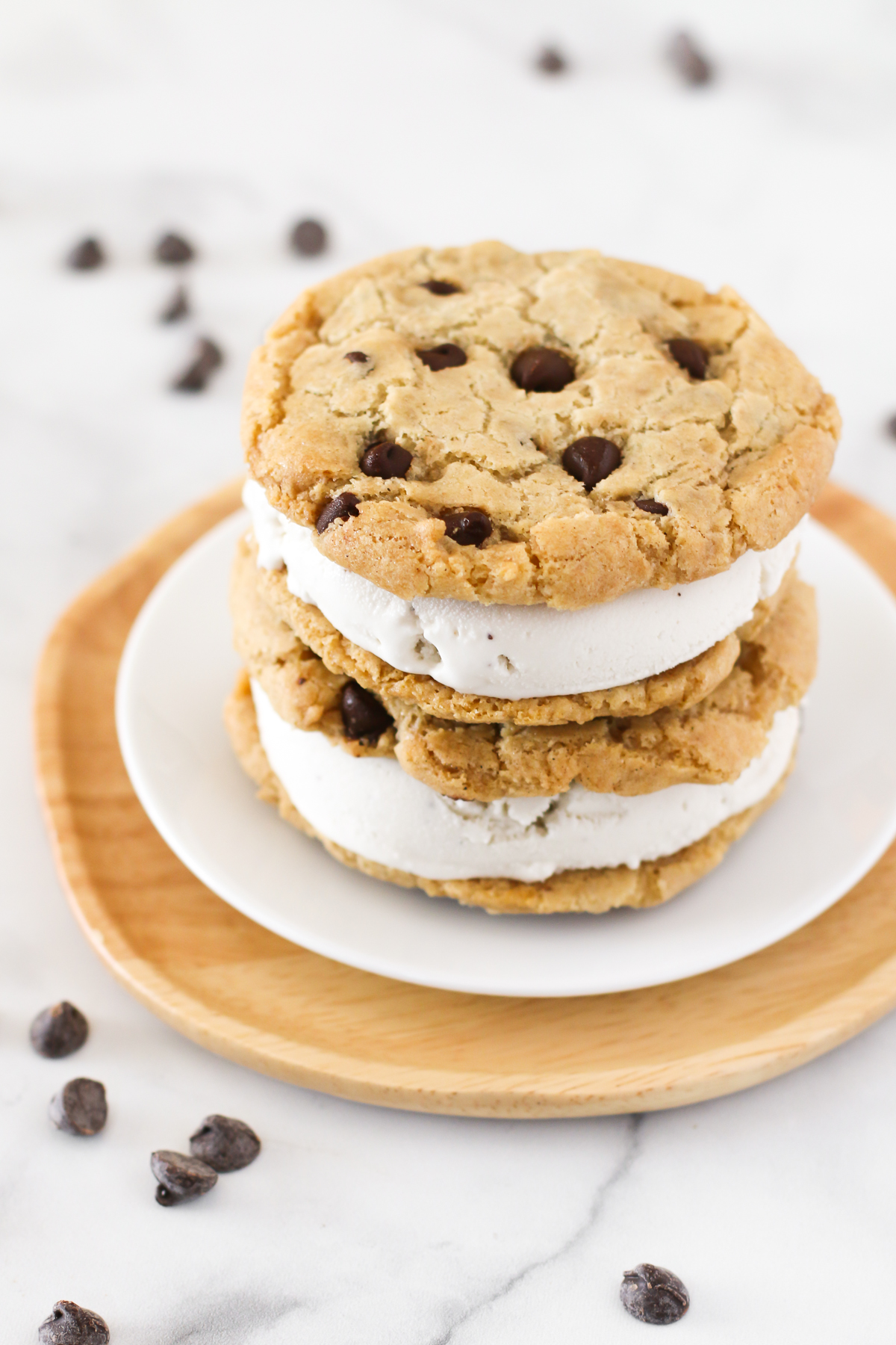 Gluten Free Vegan Chocolate Chip Cookie Ice Cream Sandwiches. Creamy vanilla ice cream, sandwiched between two chocolate chip cookies. The perfect summer treat!